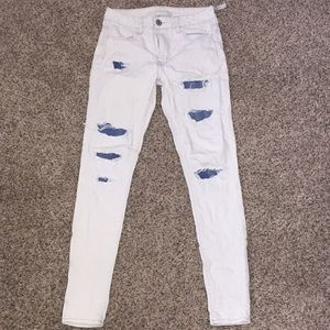 american eagle light wash jeans with blue rips
